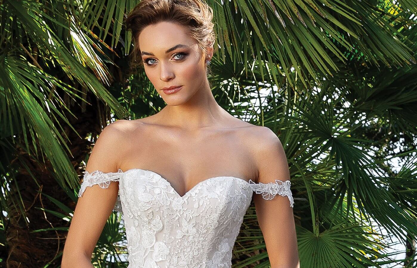 Model wearing white bridal gown