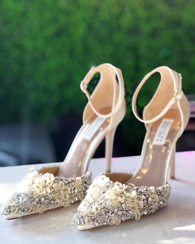 A pair of wedding shoes with 3D flowers and rhinestones